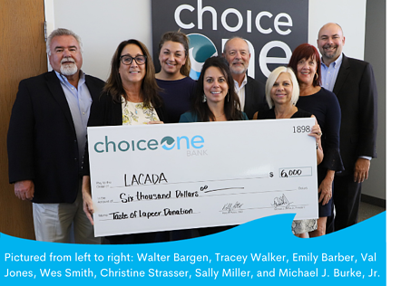 Pictured from left to right Walter Bargen, Tracey Walker, Emily Barber, Val Jones, Wes Smith, Christine Strasser, Sally Miller, Michael J. Burke Jr.