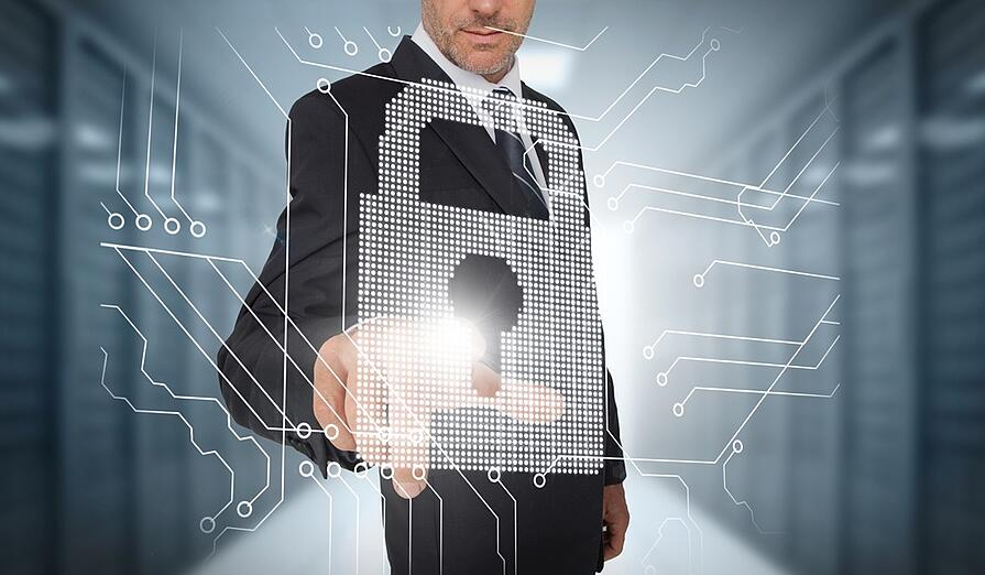 Businessman selecting a futuristic padlock with a data center on the background.jpeg